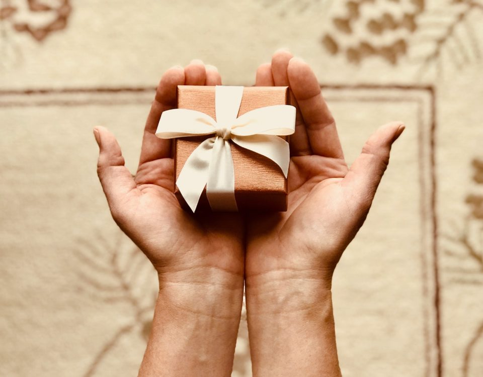 boxed gift in open hands