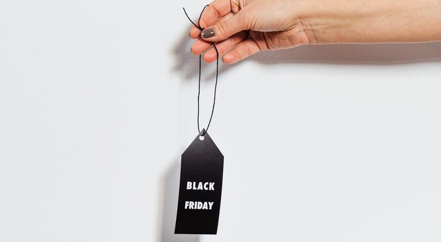 hand holding a black friday sign